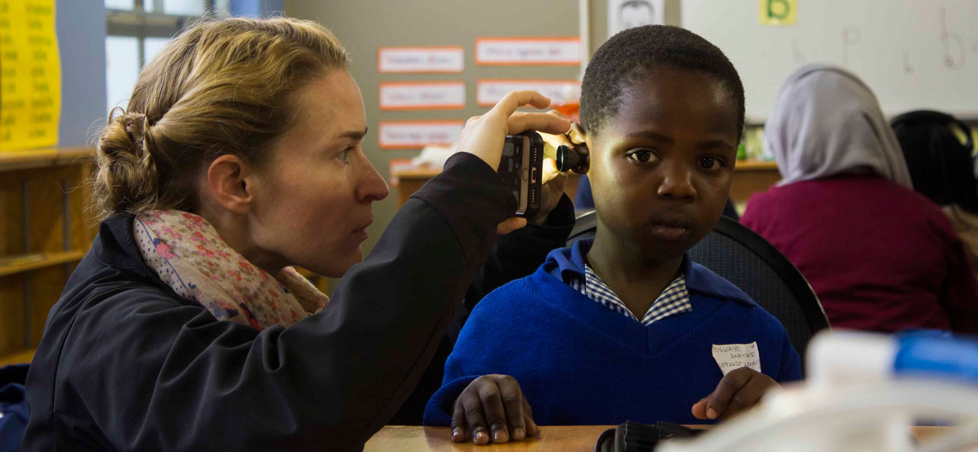 Philippi student ears being examined medical